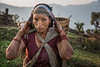 Villager in Dhampus (puuuuuuuuce) Tags: red nepal dhampus portrait