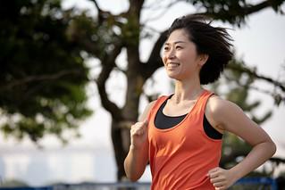 Woman running at sunset beach
