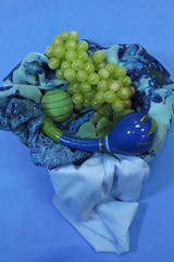 basket of blue (sselch) Tags: blue green aqua purple grapes ball basket stripes scarf flowers floral yellow vibrant fruit food