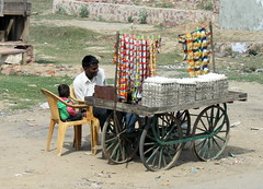 india eggs (kexi) Tags: india asia vendor eggs many man child canon february 2017 cart wheels father son people
