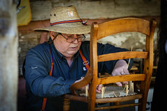 Craftsman - Hagood Mill - Pickens, S.C. (DT's Photo Site - Anderson S.C.) Tags: canon 6d 135mmf2l lens hagoodmill pickenssc southcarolina rural upstate craftsman cane bottom chair repair worker craft vintage rustic vanishing southern america usa country nostalgia straw hat porch home house
