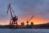 Cranes Orange Sunset (henriksundholm.com) Tags: port harbor harbour sunset cranes city urban landscape göteborg gothenburg hdr sverige sweden coast