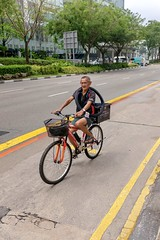 Always carry a spare (jeremyhughes) Tags: singapore bicycle cyclist cycling bike rider riding street city 35mm urban practical pedalpower workingbike road highway tyre sparetyre tire sparetire fuji fujifilm x100t fujifilmx100t