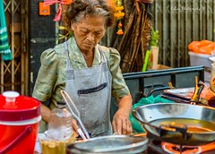 Another day (Robica Photography) Tags: thailand bangkok daytime sunny cooking woman strong routine food stand cart wok fire street road d3200 vendor work streetphotography robicaphotography art streetart