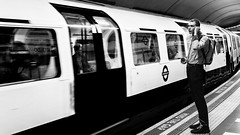 Behind The Yellow Line (Sean Batten) Tags: london england uk europe waterloo bakerlooline tube subway metro underground londonunderground person candid nikon d800 50mm blackandwhite bw city urban platform tfl