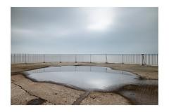 Gorleston Pier (John Pettigrew) Tags: 2470mm angles banal d750 documenting exposure haze horizon imanoot johnpettigrew lines long mundane nikon puddles railings reflection space sunlight tamron wet