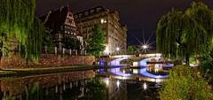 Strasbourg, France (DouxVide) Tags: france strasbourg alsace a7rii loxia loxia21 sony zeiss pont bridge brücke ponte notte nuit nacht noche puente night water canal eau reflection reflet wet summer été sommer estate light sunstars sunbursts starburst