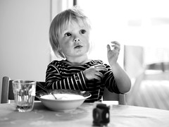Jakob (livsillusjoner) Tags: boy boys kid kids child children young monochrome bw blackwhite blackandwhite contrast black white grey portrait people eat eating food table porridge glass drinking