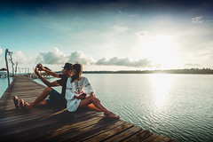 Asian couple taking a selfie by the coast on a sunny, Koh mak Trat Thailand (Patrick Foto ;)) Tags: adult ages asian background beach break bridge camera couple day female happy holding holiday island koh lifestyle mak man middle mobile nature ocean outdoors people portrait relationship relaxation sea selfie senior sitting smartphone smiling spring summer sunlight sunny sunrise sunset taking thailand tourism trat travel vacation water woman wooden young tambonkohchangtai changwattrat th