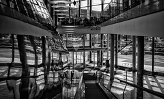 Interior with more illusions (Anne Worner) Tags: anneworner blackandwhite ricohgr silverefex architecture bw chairs downstairs glass lamps mono monochrome shoppingcenter tile upstairs windows escalator ceilinglamps reflection street car inside mygr