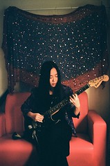 While her guitar gently weeps (kowei) Tags: musician guitar girl lady woman sofa music glitters sparkle sparkles analog film filmcamera kodak asian taiwanese room
