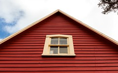 Peak (Karen_Chappell) Tags: window house peak eave red wood wooden paint painted nfld clapboard torscove cribbies avalonpeninsula architecture cabin cottage building rural yellow trim atlanticcanada canada eastcoast newfoundland irishloop