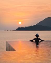 The Last Sunset In Langkawi (Stuck in Customs) Tags: langkawi malaysia treyratcliff stuckincustoms stuckincustomscom aurorahdr hdr hdrtutorial hdrphotography hdrphoto 80stays rcmemories travel sunset woman pool luxury orange sony a7r3