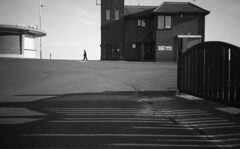 Alone (4foot2) Tags: littlehampton westsussex shadow shadows people peoplewatching interestingpeople reportage reportagephotography streetphoto streetshot street streetphotography analogue film filmphotography 35mmfilm oldfilm outofdatefilm expiredfilm experimental bw blackandwhite monochrome mono ilfordhp5 ilford hc110 kodak kodakhc110 olympustripaf50 pointandshoot 28mm wideangle 2018 fourfoottwo 4foot2 4foot2flickr 4foot2photostream