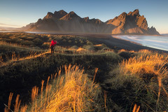 Photographing Vestrahorn in Summer (Iurie Belegurschi www.iceland-photo-tours.com) Tags: adventure arctic beautiful beach blacksandbeach black coastal daytours dreamscape extremeterrain extreme fineart fineartphotography fineartlandscape fineartphotos finearticeland guidedphotographyworkshops guidedtoursiceland guidedphotographytour guidedtoursiniceland hill icelandphototours iceland iuriebelegurschi icelandic icelanders icelandphotographyworkshops icelandphotoworkshops icelandphotographytrip landscape landscapephotography landscapephoto landscapes landscapephotos landofthemidnightsun midnightsun mountain midnight nature outdoor outdoors phototours photographyiniceland phototour photographyworkshopsiniceland tranquil summer serene sunset seascape sea sun tours travelphotography travel tripsiceland tutorials view vestrahorn workshop water workshops stokksnes sandy grass red redjacket