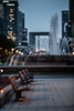 Benches & La Défense (eddy_737) Tags: canon benches bench evening bokeh dof lights nightlignts paris travel fonain arch ladéfense city town business businessdistrict alone
