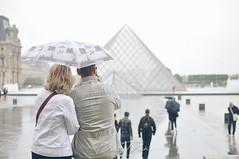 Couple in Louvre (WhatACameraSees) Tags: louvre couple love france paris rain