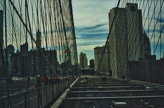 New York City - New York - Manhattan - Brooklyn Bridge - View from Walkway (Onasill ~ Bill Badzo) Tags: brooklyn bridge newyork city nyc manhattan walkway cable hybrid suspension onasll nrhp landmark oldest unitedstates 1869 east river icon onasill civil engineering vintage old photo woolworths building tower municipal people sky clouds