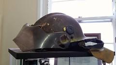 Burnt helmet from the 2003 Canberra Firestorm (ats_500) Tags: actfirebrigade firefighter firefighting helmet 2003canberrafirestorm fire firedepartment canberra firemuseum australia