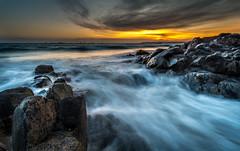 La Mare 4th April 2018 (Tim_Horsfall) Tags: sea coast ocean rocks water tide jersey sunset clouds sky yellow blue golden waves shore landscape seascape fujifilm