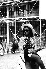 looking far off (pascalcolin1) Tags: paris beaubourg centregeorgespompidou femme woman lunettesdesoleil sun sunglasses soleil rayures photoderue streetview urbanarte noiretblanc blackandwhite photopascalcolin 50mm canon50mm canon