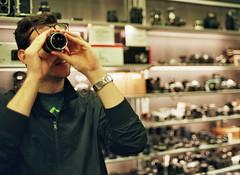 Spy Glass (Jetcraftsofa) Tags: nikonf3 nikkor0352 reala100 35mm slr filmphotography camerashop spyglass availablelight