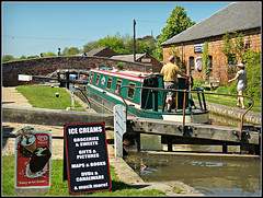 Fancy an Ice Cream? (Jason 87030) Tags: braunston bottomlock cut canal shop advert aboard boat narrowboat may 2018 toohot| evil horrible nasty sunny uk scene man woman icecream souvenirs muchmore local walk grandunioncanal england weather terrible icelolly drinks thirk cool northants northamptonshire frame border
