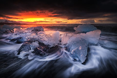 Dark Mornings (KasparsDz) Tags: iceland landscape jokulsarlon beach waves long exposure dark sunrise sun ice moody dramatic tours beauty clouds ocean sea red game thrones blue cold dzenis photography
