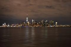 The City That Never Sleeps (Comiccreator24) Tags: newyork nyc digitalphotography dslr d3400 d3400photographer nikonography nikon nikonphotographer nikond3400 nikondslr nikond3400photographer newyorkcity manhattan hudsonriver lowermanhattan nightphotography night photography atnight march2018 2018 2018inphotos skyline city cityskyline cityscape megacity