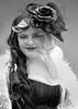 Pretty Steampunk Woman (J Wells S) Tags: steampunkwoman smile prettyyoungwoman veil hat boa featherboa blackandwhite bw monochrome portrait candidportrait internationalsteampunksymposium ramadaplaza sharonville cincinnati ohio dressup cosplay costume
