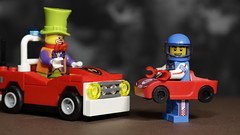 A friendly game of 'bumper cars' (N.the.Kudzu) Tags: tabletop lego minifigures clown racecardriver canondslr canonefslenses flash