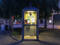 Swiss Phone Booth (Lux Llama Productions) Tags: tone yellow lighting dim europe swisscom payphone call small outdoor booth vintage telephone phone switzerland swiss
