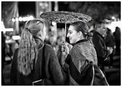 In conversation (gro57074@bigpond.net.au) Tags: blackwhite hornsbyfoodfestival nikond850 sigmaart 50mmf14 d850 nikon smile inconversation twowomen candid foodfestival durallnfair sydney hornsby umbrella blackandwhite
