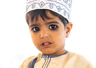 Cute omani boy with kohl on his eyes, Nizwa Oman