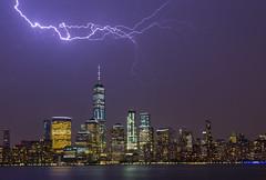 Lightning, NYC ([ raymond ]) Tags: clouds hudsonriver lightning manhattan nyc sky skyline storm weather img0568 cityscape