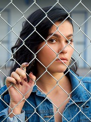 Don't Fence Her In (The Good Brat) Tags: colorado us female woman girl fashion style model brunette pretty portrait pose closeup fence frame denim hand manicure