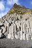 Cliffs below Reynisfjal (mountain) (wyojones) Tags: reynisfjal reynisfjara vík víkímýrdal iceland southiceland basalt blacksand beach mountain cliff columnarbasalt coolingcracks columns igneousrock volcanics extrusive rock geology people tourists pose sitting