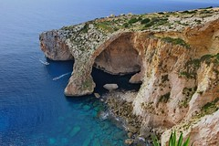 Boat Trippers (Douguerreotype) Tags: boat arch malta blue landscape water