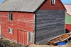 Weathered (halifaxlight) Tags: norway hordaland fedje fishingsheds sheds boat door windows weathered red green blue angles boards grey