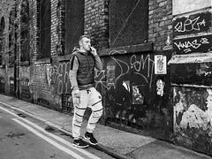 Northern Quarter 237 (Peter.Bartlett) Tags: manchester niksilverefex window unitedkingdom people facade graffiti walking doubleyellowlines streetphotography cellphone olympuspenf peterbartlett man urban shutter candid uk m43 microfourthirds mobilephone bw noiretblanc wall blackandwhite monochrome city england gb