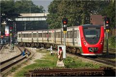 A Commuter Train leaves Chittagong (Trains In Tasmania) Tags: bangladesh chittagong train passengertrain bangladeshrailway telephoto commutertrain railcar dieselrailcar ef35350mm13556lusm canoneos550d stevebromley trainsintasmania