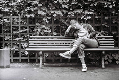 Just Reading (danteavv) Tags: blackwhite filmphotography manualcamera street streetphotography saintpetersburg zenit12 helios44 ilford