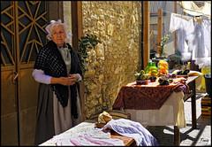 - Waiting - (Tomas Mauri) Tags: waiting navarcles mujer ropa muñeca esperando clle fiesta fira medieval elbages catalunya calalonia spain puerta ropatendida mesas pared