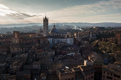Overlooking Siena, Tuscany, Italy (Jason Clifton) Tags: towerofmangiasiena tuscany italy canon canon5dmarkiii 5dmarkiii 5dm3 ef35mmf14lusm 35mmf14l 35mm 35mml documentary photojournalism nationalgeographic natgeo primelens nozoom noflash availablelight existinglight naturallight architecture jasonclifton jasoncliftonflickr flickrjasonclifton sky clouds goldenhour dusk sunset landscape ngc