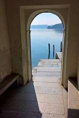 Viewfinding (little_frank) Tags: isolasangiulio piedmont italy portico arch lake horizon light lakeorta architecture shore stairs door italia peace peaceful quiet silence silent stillness lagodorta piemonte view still fixed frame tranquil italian motionless smooth gentle scape shadow