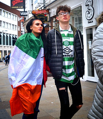 Fashion Republic (Owen J Fitzpatrick) Tags: ojf people photography nikon fitzpatrick owen pretty pavement chasing d3100 ireland editorial use only ojfitzpatrick eire dublin republic city tamron candid joe candidphotography candidphoto unposed natural attractive beauty beautiful woman female lady j along black photoshoot street st saint patricks day festival baile atha cliath dubh linn grafton flag tricolor tricolour orange green brunette man male stripe 3 hair celtic fc football soccer scotland umbro glasses spectacles three fashion jersey shirt