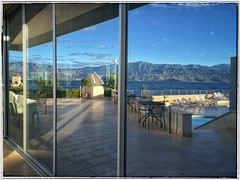 IMG_7980_2 (Rob Rocke) Tags: postira brac croatia dalmatia adriaticsea window reflection seascape vbt hotelpastura patio pool unstuckintime snapseed thegoldenhour themagichour