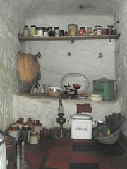 A cool larder (bryanilona) Tags: larder pantry storage sandstone breadbin paraffinlamp basket bottles jars quarrytiles fletcherhouse cavedwellings kinver holyaustinrock scales bowls dishes mincer vegetables