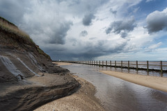 Chased by water (StuMcP) Tags: wet walcott happisburgh stuartmcpherson tide rain storm canon5dmkiii clouds beach seadefence northsea norfolk