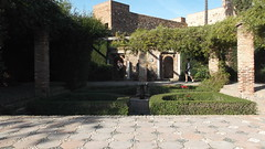 DSCF0988 (rugby#9) Tags: topiary plant outdoor yard flower flowerbed alcazaba málaga building architecture columns brick stone stonework andalucia people fountain water waterfeature cobbles pebbles tiles hedge costadelsol alcazabademalaga